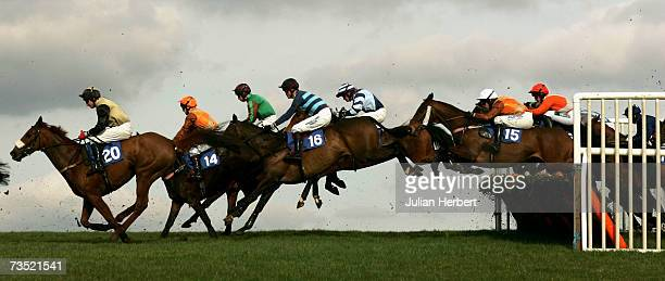 Runners clear the first hurdle during The Subscribe To Racing UK Handicap Hurdle Race run at Wincanton Racecourse on March 8 in Wincanton England