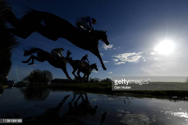 Runners clear the water jump during the SJH Carpets Handicap Steeple Chase at Wincanton Racecourse on March 25 2019 in Wincanton England