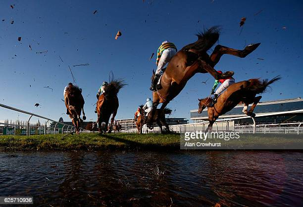Runners clear the water jump in The bet365 Steeple Chase at Newbury Racecourse on November 25, 2016 in Newbury, England.