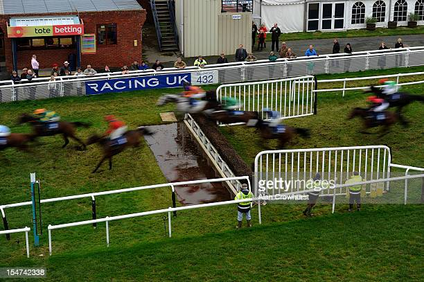 Runners clear the water jump in The Bluefin Insurance Solutions Welshpool Handicap Steeple Chase at Ludlow racecourse on October 25 2012 in Ludlow...