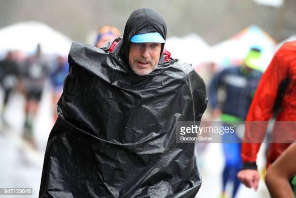 Runners climb Heartbreak Hill during the Boston Marathon in Newton Mass April 16 2018