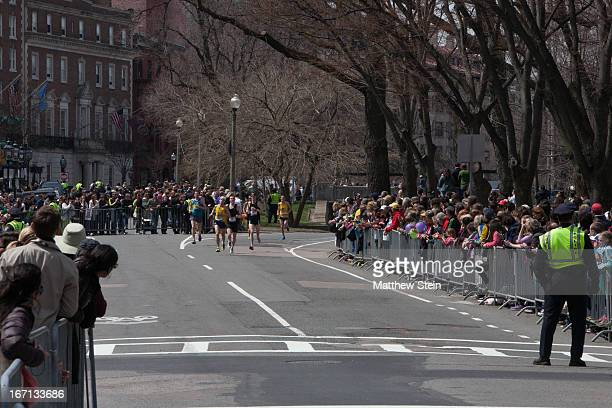 Runners come down the final mile of Commonwealth Avenue for the 2013 Boston Marathon