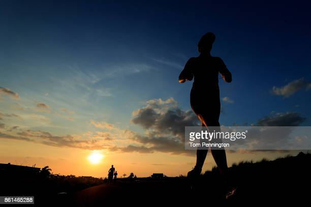 Runners compete as the sun is setting during the IRONMAN World Championship on October 14 2017 in Kailua Kona Hawaii