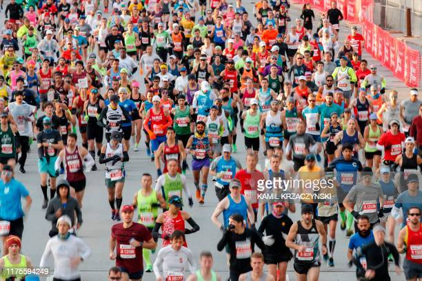 TOPSHOT Runners compete during the 2019 Bank of America Chicago Marathon on October 13 2019 in Chicago Illinois Kenya's Brigid Kosgei shattered Paula...
