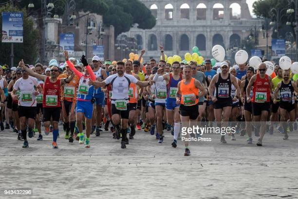 Runners compete during the 24th edition of the Maratona di Roma an annual IAAF marathon competition hosted by the city of Rome Italy on April 08 2018...