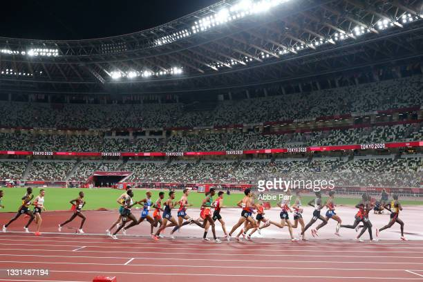 Runners compete during the Men's 10,000 meters final on day seven of the Tokyo 2020 Olympic Games at Olympic Stadium on July 30, 2021 in Tokyo, Japan.
