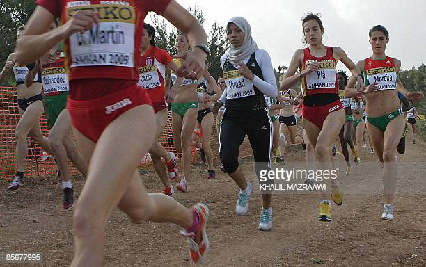 Runners compete during the senior women's race at the 37th International Association of Athletics Federations World Cross Country Championships in...