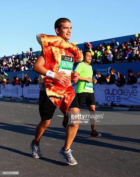Runners compete during the Standard Chartered Dubai Marathon on January 23 2015 in Dubai United Arab Emirates