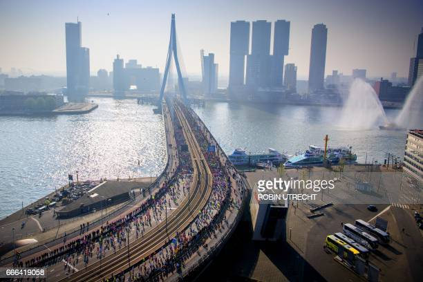 Runners compete in 37th edition of the Rotterdam Marathon as they cross Erasmus Bridge in Rotterdam Netherlands on April 9 2017 / AFP PHOTO / ANP /...