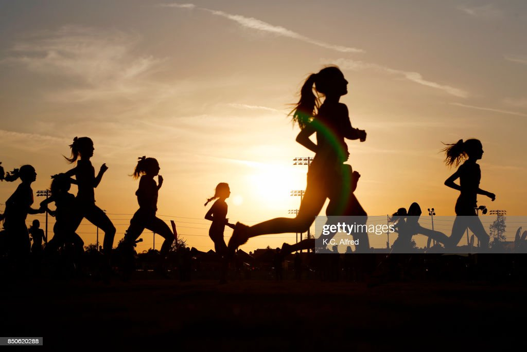 Runners compete in a 5k at sunset in Corona, California. : Stock-Foto