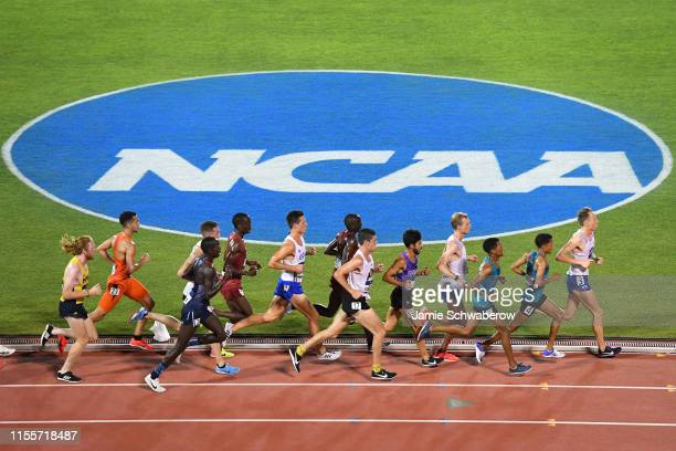 Runners compete in the 10,000 meter run during the Division I Men's and Women's Outdoor Track & Field Championships held at Mike A. Myers Stadium on...