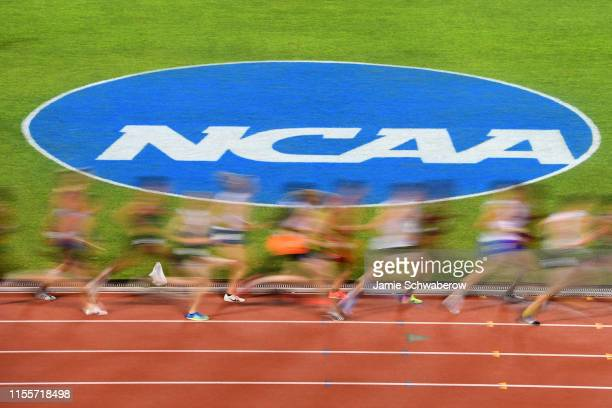 Runners compete in the 10000 meter run during the Division I Men's and Women's Outdoor Track Field Championships held at Mike A Myers Stadium on June...