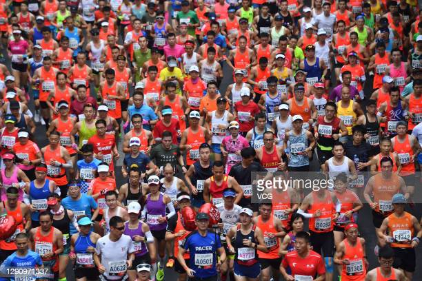 Runners compete in the 2020 Guangzhou Marathon on December 13, 2020 in Guangzhou, Guangdong Province of China.