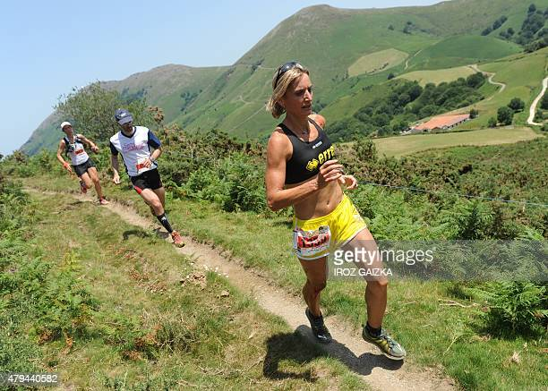 Runners compete in the 26km race of 40th edition of the Course des Cretes race on July 4 2015 in Espelette southwestern France Some 5000 runners took...