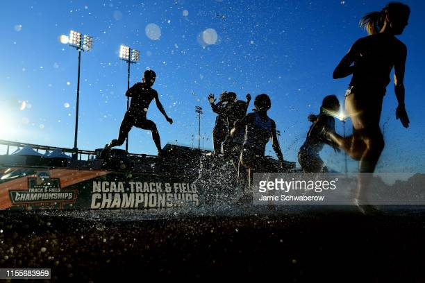 Runners compete in the 3000 meter steeplechase preliminaries during the Division I Men's and Women's Outdoor Track & Field Championships held at Mike...