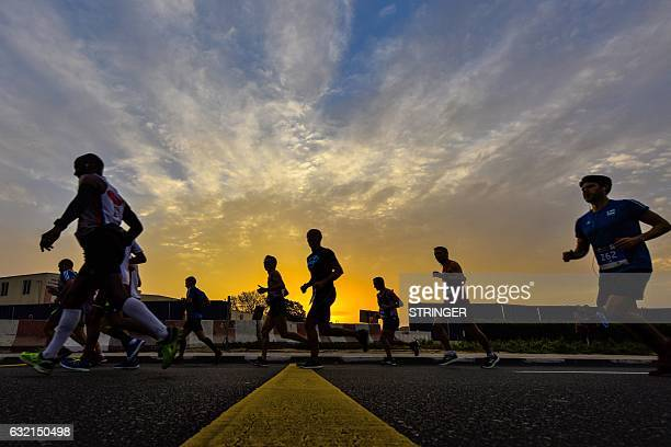 TOPSHOT Runners compete in the Dubai Marathon in the Gulf emirate on January 20 2017 Middle distance legend Kenenisa Bekele who was aiming to add the...