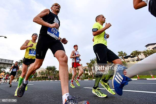 Runners compete in the Dubai Marathon in the Gulf emirate on January 20 2017 Middle distance legend Kenenisa Bekele who was aiming to add the...