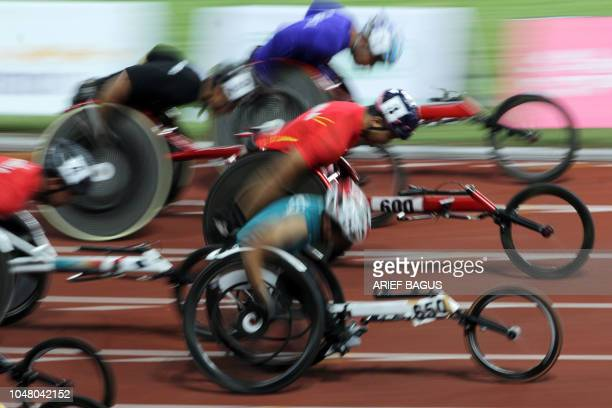 Runners compete in the men's 100 metre T54 of the 2018 Asian Para Games in Jakarta on October 9 2018