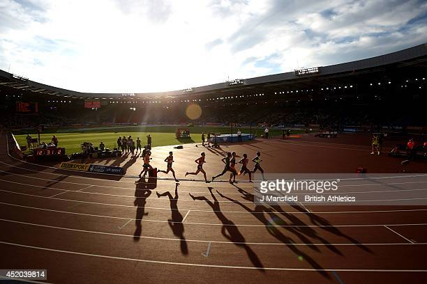 Runners compete in the Men's 5000m during the IAAF Diamond League Day 1 at Hampden Park on July 11 2014 in Glasgow Scotland