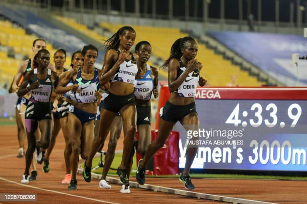 Runners compete in the Women's 3000m during the IAAF Diamond League competition on September 25, 2020 at the Suheim Bin Hamad Stadium in the Qatari...