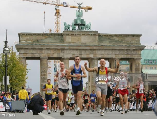 Runners compete the 34th Berlin Marathon near the Brandenburg Gate on September 30 2007 in Berlin Germany