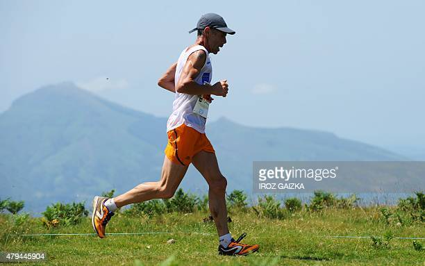 A runners competes in the 26km race of 40th edition of the Course des Cretes race on July 4 2015 in Espelette southwestern France Some 5000 runners...