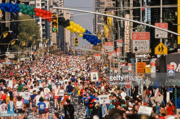 Runners competing in the 1988 New York City Marathon run on First Avenue in Manhattan approximately midway through the race on November 6, 1988 in...