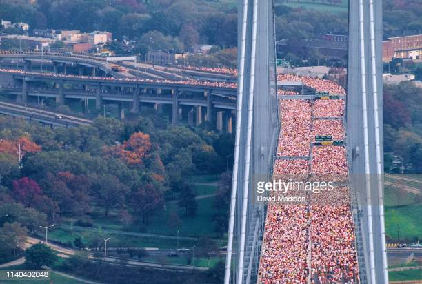 Runners competing in the 1990 New York City Marathon cross the Verrazzano Bridge from Staten Island to Brooklyn near the beginning of the race on...