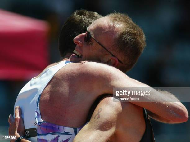 Runners congratulate one another after the Men's 5000 metre final during the 2002 Sydney Gay Games at the Homebush Athletics Centre in Sydney...