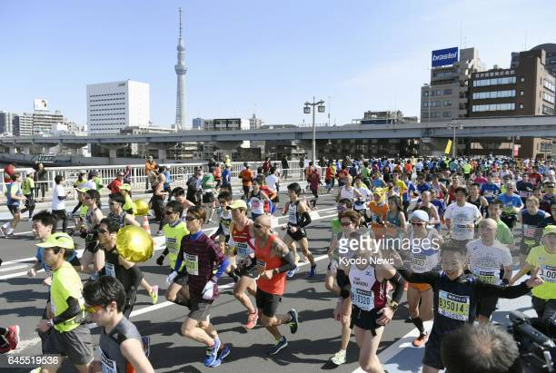 Runners cross Kuramae bridge during the Tokyo Marathon on Feb 26 with the Tokyo Skytree seen in the background ==Kyodo