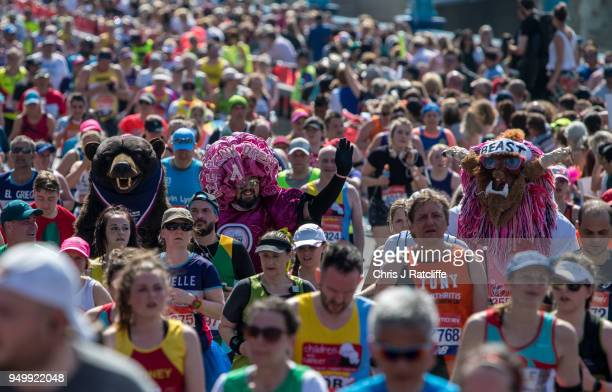 Runners cross over Tower Bridge during the London Marathon at United Kingdom on April 22 2018 in London England 40000 runners are taking part in the...