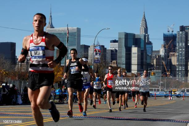 Runners cross the 44th Dr, during the New York City Marathon in Queens Borough of New York, United States on November 04, 2018.