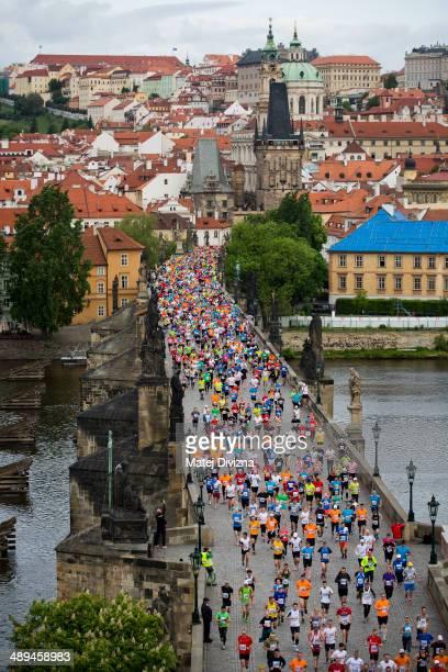 Runners cross the Charles Bridge during the Prague International Marathon on May 11 2014 in Prague Czech Republic