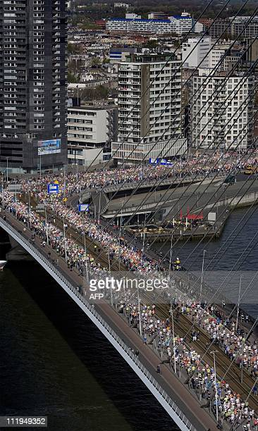 Runners cross the Erasmus Bridge as they compete in the Rotterdam Marathon in Rotterdam on April 10 2011 AFP PHOTO/ANP/GUUS SCHOONEWILLE netherlands...