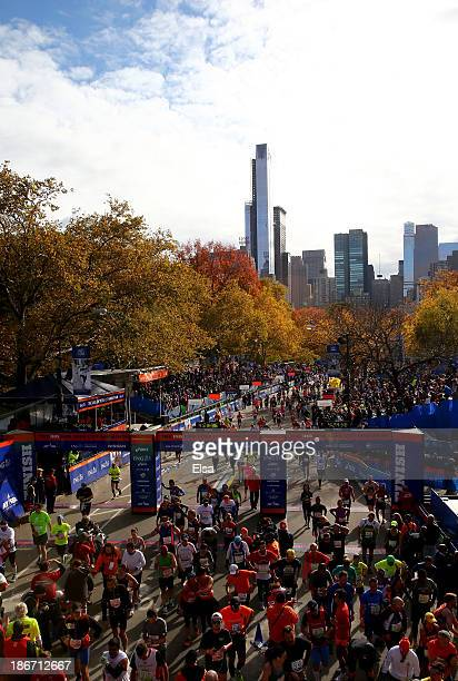 Runners cross the finish line in Central Park during the 2013 ING New York City Marathon on November 3 2013 in New York City