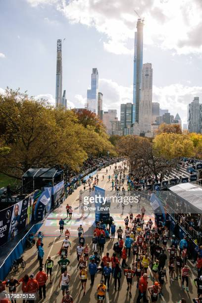 Runners cross the finish line in Central Park during the TCS New York City Marathon on November 3, 2019 in New York City.