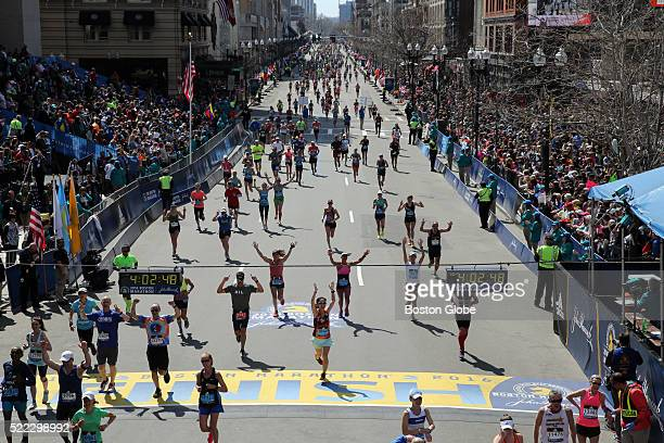 Runners cross the finish line of the 120th Boston Marathon on Monday April 18 2016 More than 30000 participants registered for the 2016 Boston...