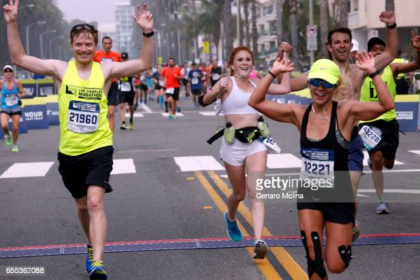 Runners cross the finishing line in the 32nd annual Los Angeles Marathon in Santa Monica on March 16 2017