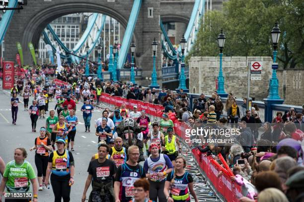 Runners cross the half way point on Tower Bridge during the London Marathon in London on April 23 2017 / AFP PHOTO / CHRIS J RATCLIFFE
