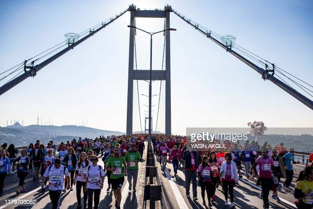 TOPSHOT Runners cross the July 15 Martyrs' Bridge known as the Bosphorus Bridge as they compete in the 41st annual Istanbul Marathon on November 3 in...