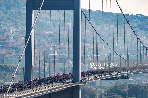 Runners cross the July 15 Martyrs' Bridge known as the Bosphorus Bridge as they compete in the 41st annual Istanbul Marathon on November 3 in Istanbul