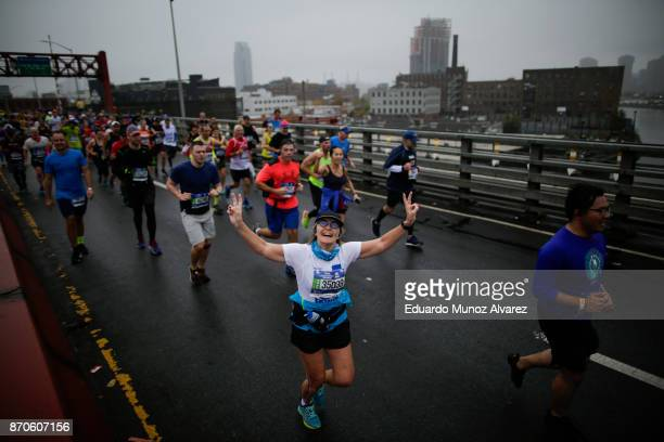Runners cross the Pulaski Bridge from Brooklyn into Queens during 2017 TCS New York City Marathon November 5 2017 in New York NYPD department had...