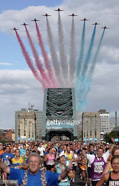 Runners cross the Tyne Bridge as the Red Arrows fly over during the Bupa Great North Run at South Shields on September 30 2007 in Newcastle England