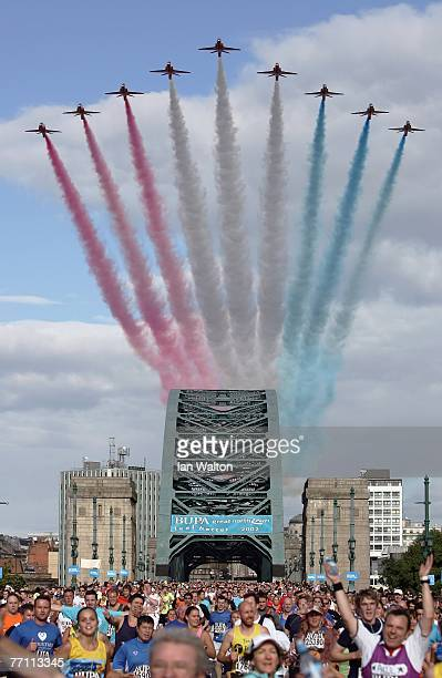SEPTEMBER 30 Runners cross the Tyne Bridge as the Red Arrows fly over during the Bupa Great North Run at South Shields on September 30 2007 in...