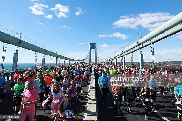 Runners cross the VerrazanoNarrows Bridge at the start of the 2016 TCS New York City Marathon on November 6 2016 in the Brooklyn borough of New York...