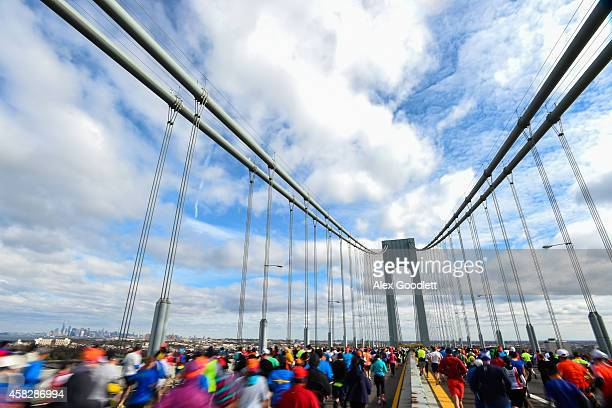 Runners cross the VerrazanoÐNarrows Bridge at the start of the TCS New York City Marathon on November 2 2014 in the Brooklyn borough of New York City