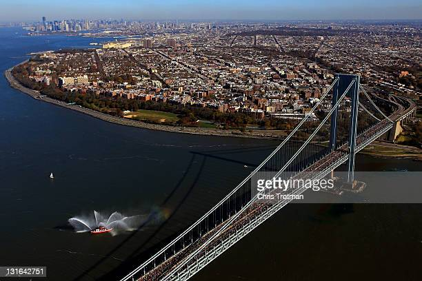 Runners cross the VerrazanoNarrows Bridge towards Brooklyn at the start of the ING New York City Marathon as seen from the air on November 6 2011 in...