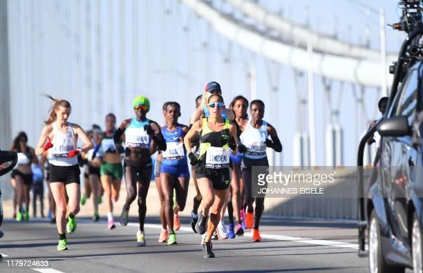 Runners cross the VerrazzanoNarrows Bridge during the 2019 TCS New York City Marathon in New York on November 3 2019