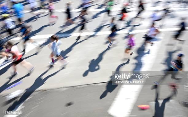 TOPSHOT Runners cross the VerrazzanoNarrows Bridge during the 2019 TCS New York City Marathon in New York on November 3 2019