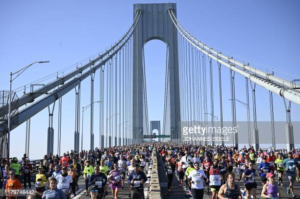Runners cross the Verrazzano-Narrows Bridge during the 2019 TCS New York City Marathon in New York on November 3, 2019.